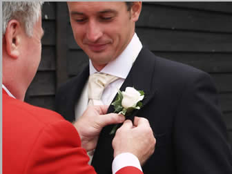 Essex wedding toastmaster assisting Bride Groom with button hole